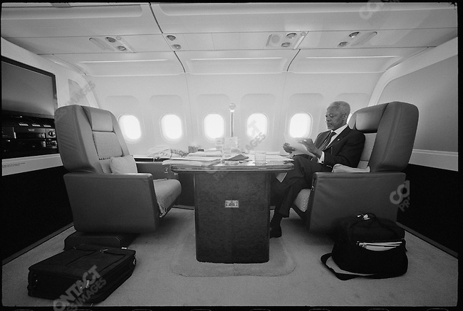 United Nations Secretary-General Kofi Annan on a plane to Pakistan for a meeting with Afghan Taliban leaders. March 2001