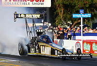 Nov 7, 2013; Pomona, CA, USA; NHRA top fuel dragster driver Tony Schumacher during qualifying for the Auto Club Finals at Auto Club Raceway at Pomona. Mandatory Credit: Mark J. Rebilas-
