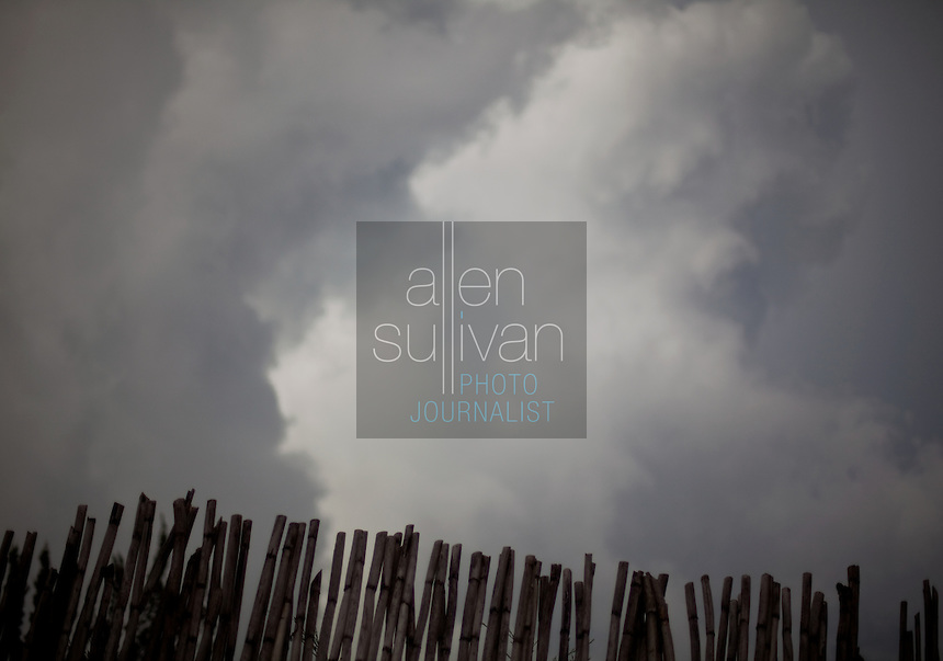 Clouds over a bamboo fence in San Marcos la Laguna, Sololá, Guatemala.