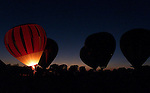 "*DIGICAM*.Ballonists conducts a ""balloon  glow"" at sunset during the 13th Annual Highland Village Balloon Festival presented by the Highland Village Lions Club on Friday August 20, 1999 at Copperas Branch Park..Star-Telegram/Khampha Bouaphanh"