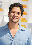 LOS ANGELES, CA - APRIL 12: Actor Tyler Posey arrives at the 2015 MTV Movie Awards at Nokia Theatre L.A. Live on April 12, 2015 in Los Angeles, California.