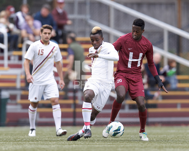 Boston College midfielder Derrick Boateng (10) dribbles as Harvard University forward Ashi Geberkidane (20) defends.Boston College (white) defeated Harvard University (crimson), 3-2, at Newton Campus Field, on October 22, 2013.