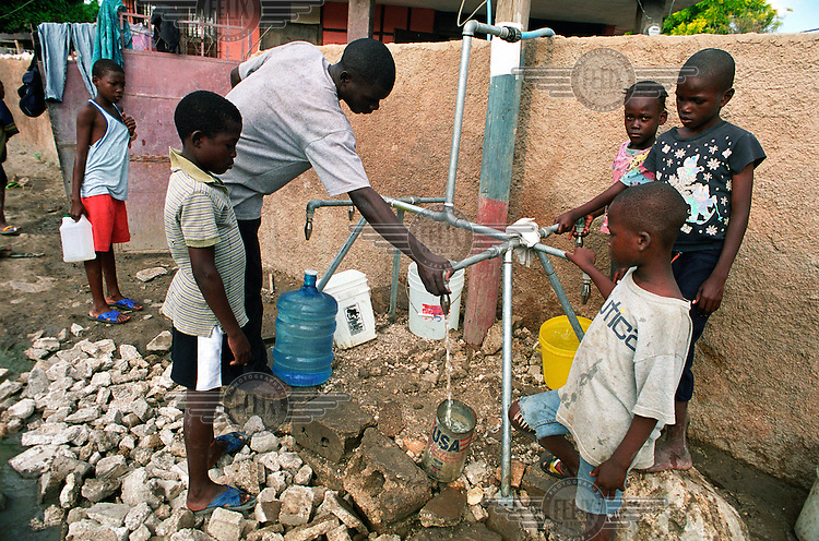 Water distribution. Three weeks after tropical storm Jeanne hit the city of Gonaives parts of the Asifa neighbourhood are still flooded. Over 2700 people were reported dead or missing. Haiti is particularly vulnerable to flooding after heavy rainfall due to intense deforestation....