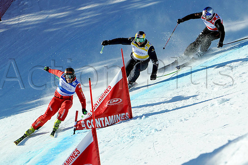 15.01.2012 Les Contamines, France.  Freestyle Skiing FIS World Cup Ski Cross the men Picture shows Conradign Netzer SUI John Plate USA and Tomas Kraus CZE