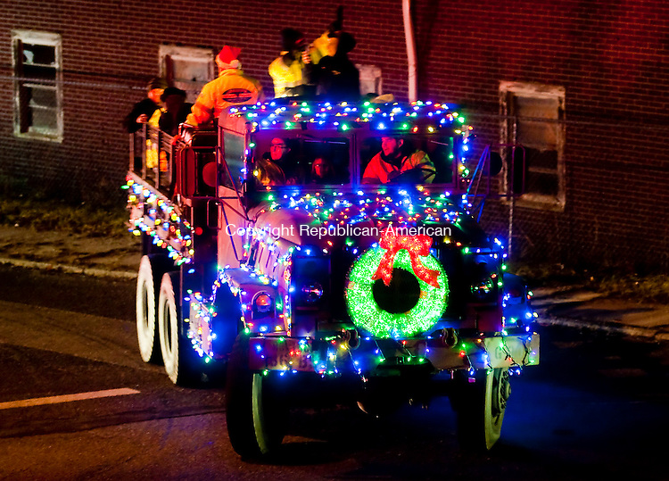 WINSTED, CT--- -121915JS06--Decorated fire trucks turn onto Lake Street from Meador Street in Winsted as they begin the 11th annual Winsted Fire Department &quot;Gator&quot; Christmas Parade on Saturday. The parade continues to honor the tradition of former firefighter Gaeton &quot;Gator&quot; Gangi who started the parade in 2004 as a community Christmas parade. <br /> Jim Shannon Republican-American