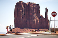Tourists snap photos at Monument Valley Navajo Tribal Park in southern Utah. The park, operated by teh tribe, was once a popular set for western films of the 1930s through 60s. It is immensely popular among European tourists. (Kevin Moloney for the New York Times)