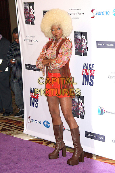 NATALIE COLE<br /> 13th Annual Race to Erase MS - Arrivals held at the Hyatt Regency Century Plaza Hotel, Century City, California, USA, 12 May 2006.<br /> full length blonde afro wig funny costume seventies platforms<br /> Ref: ADM/ZL<br /> www.capitalpictures.com<br /> sales@capitalpictures.com<br /> &copy;Zach Lipp/AdMedia/Capital Pictures
