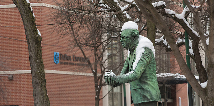 Snow coats the statue of Monsignor John Egan Tuesday, Feb. 4, 2015, on the Lincoln Park Campus of DePaul University in Chicago following a record-setting blizzard. (Photo by Jamie Moncrief)