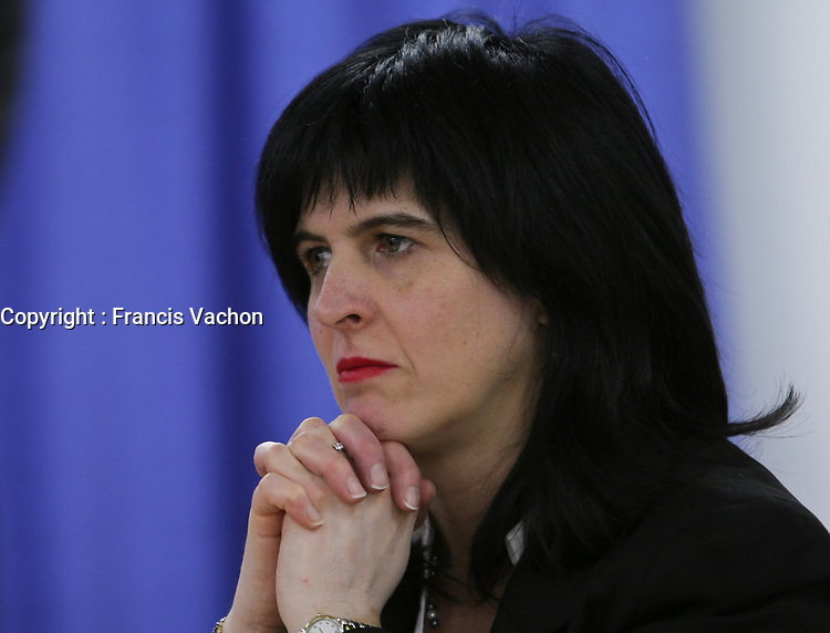 Martine Valois listens as commissioner Michel Bastarache unveils the report of his inquiry in the appointment of judges, commonly know as the Commission Bastarache, Wednesday January 19, 2011.<br /> <br /> PHOTO :  Francis Vachon - Agence Quebec Presse