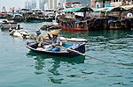 Aberdeen harbour, Hong Kong Island  A couple fishes in the crowded Aberdeen Harbour, near Hong Kong.