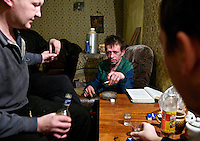 Alexander Krashevski, who says he looks older, but is only 35, drinks with friends in his apartment. An alcoholic who started drinking at school when he was 14. <br /> Alexander was originally from Murmansk City, capital of Murmansk Province. Four years ago, he and his 26 year old brother, Yuri, moved to Revda, a crumbling 'Mono-city' where the whole town is hanging on the fate of a single, dying factory. The local population is falling sharply, replaced, in part, by an influx of alcoholics like Alexander in search of cheap living. /Felix Features
