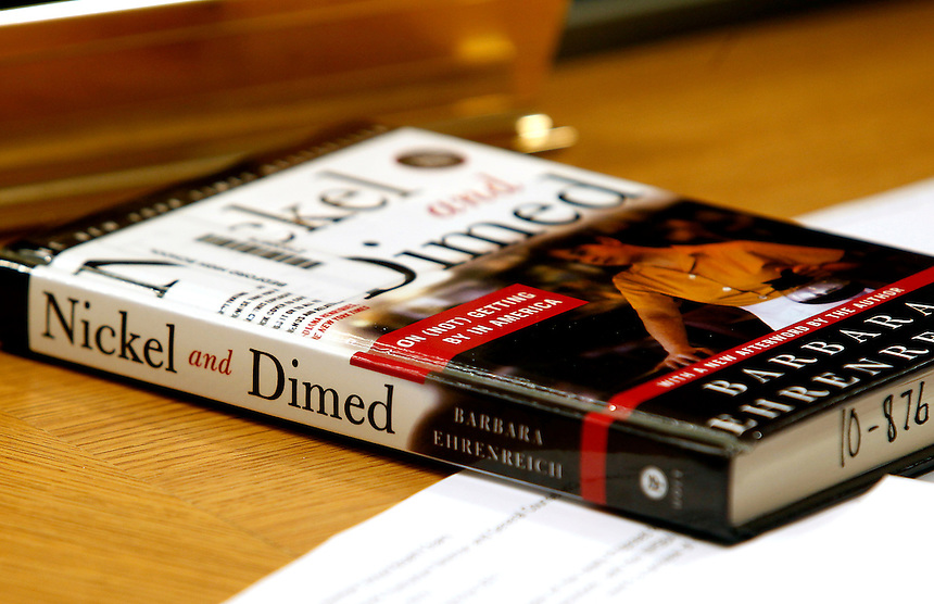 "Parents, Aimee and Dennis Taylor are asking that the book, ""Nickel and Dimed: On (Not) Getting By in America"", be removed from the school curriculum during a meeting in Bedford, N.H., Monday, Dec. 13, 2010.  (AP Photo/Cheryl Senter) ."
