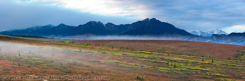 Morning fog over the tundra and Alaska Range mountains, Denali National Park, Interior, Alaska.