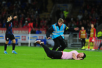 A pitch invader disturbs play during the UEFA Euro 2020 Qualifier between Wales and Croatia at the Cardiff City Stadium in Cardiff, Wales, UK. Sunday 13 October 2019