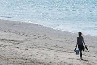Aberystwyth Wales Uk, Sunday 08 May 2016<br /> A woman walks on the beach<br /> UK Weather : As temperatures reach the upper 20's centigrade in parts of Britain, people enjoy the warm May sunshine in Aberystwyth on the Cardigan Bay coast in West Wales.