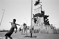 Kids play street baseball, a variation on the traditional American game — in the streets of Havana, Cuba. Despite political conflict with the United States since the 1959 revolution, Cubans love the American passtime.
