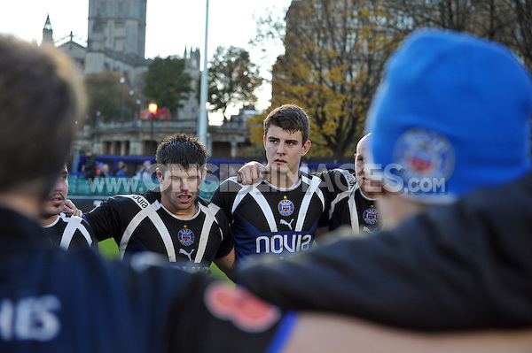 Olly Devoto looks on in a huddle. LV= Cup match, between Bath Rugby and the Newport Gwent Dragons on November 10, 2012 at the Recreation Ground in Bath, England. Photo by: Patrick Khachfe / Onside Images