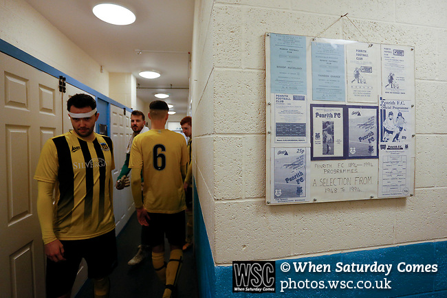 Hebburn's Matthew Tumilty emerges for the second half, next to a selection of framed Penrith programmes. Penrith AFC V Hebburn Town, Northern League Division One, 22nd December 2018. Penrith are the only Cumbrian team in the Northern League. All the other teams are based across the Pennines in the north east.<br />