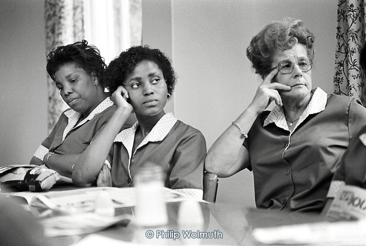 1986: newly contracted-out domestic workers at St.Charles Hospital, Notting Hill, hold a lunchtime union meeting over pay and conditions.
