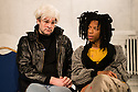 London, UK. 05.03.2013. A THOUSAND MILES OF HISTORY, a new play, written and directed by Harold Finley, opens at the Bussey Building, The Royal Court's theatre local, in Peckham Rye. The play is set in the 1980s and centres on the relationship by the three artists: Andy Warhol, Keith Haring and Jean-Michel Basquiat. Picture shows: Adam Riches (Andy Warhol) and Michael Walters (Jean-Michel Basquiat). Photo credit: Jane Hobson.