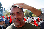 A injured protester during clashes between Anarchists and Communists. Greek unions protest for second day against a new round of austerity measures outside the Greek parliament.