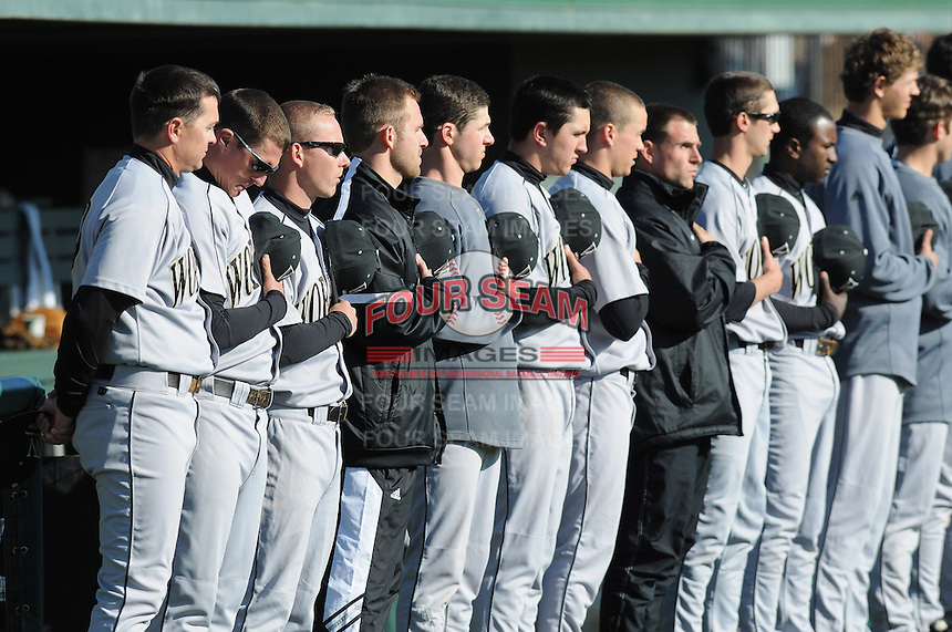Members of the Wofford Terriers during the National Anthem prior to a game against the the Clemson Tigers on Wednesday, March 6, 2013, at Doug Kingsmore Stadium in Clemson, South Carolina. Clemson won, 9-2. (Tom Priddy/Four Seam Images)