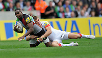 England. Ugo Monye of Harlequins tackled by Chris Wyles of Saracens in action during the Aviva Premiership match between Harlequins  and Saracens at Twickenham Stoop on September 30. 2012 in Twickenham, England.
