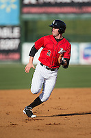 Landon Lassiter (2) of the Kannapolis Intimidators keeps an eye on the ball in left field as he hustles towards third base against the Hickory Crawdads at Kannapolis Intimidators Stadium on April 10, 2016 in Kannapolis, North Carolina.  The Intimidators defeated the Crawdads 10-3.  (Brian Westerholt/Four Seam Images)