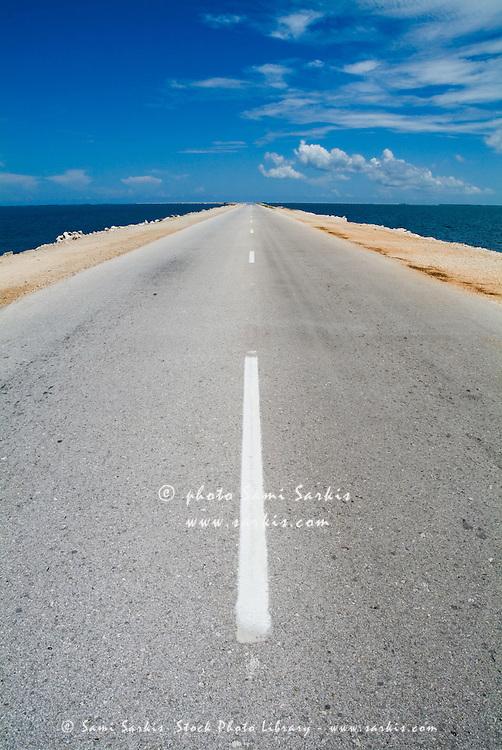 White dividing line marking a road going to Cayo Santa-Maria, Cuba.