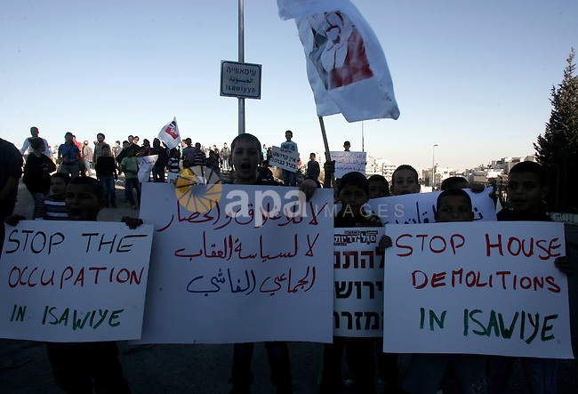 Palestinians take part in a protest in the east Jerusalem neighborhood of Issawiyeh, Friday, Dec. 3, 2010 against Israel's house demolitions in Issawiyeh. Photo by Mahfouz Abu Turk