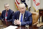 United States President Donald Trump speaks during a listening session on domestic and international human trafficking in the Roosevelt Room of the White House on February 23, 2017 in Washington, DC.  To the President's right is Gary Haugen, CEO and Founder, International Justice Mission. <br /> Credit: Olivier Douliery / Pool via CNP