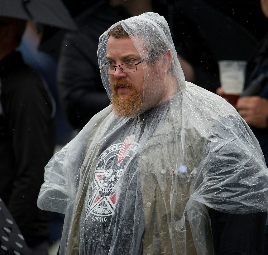 A fan hopes for the rain to stop and play recommence at Edgbaston <br /> <br /> Photo by Stephen White/CameraSport<br /> <br /> International Cricket - NatWest Series - 3rd ODI -  England v Australia - Wednesday 11th September 2013 - Edgbaston, Birmingham<br /> <br /> &copy; CameraSport - 43 Linden Ave. Countesthorpe. Leicester. England. LE8 5PG - Tel: +44 (0) 116 277 4147 - admin@camerasport.com - www.camerasport.com