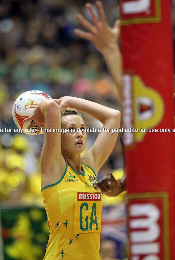 09.07.2011 Australia's Natalie Medhurst in action during the netball match between Jamaica and Australia at the Mission Foods World Netball Championship 2011 held at the Singapore Indoor Stadium in Singapore . Mandatory Photo Credit ©Michael Bradley.