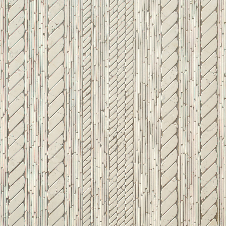 Cardigan, a waterjet and hand-cut stone mosaic, shown in tumbled Bianco Antico, is part of the Tissé® collection for New Ravenna.
