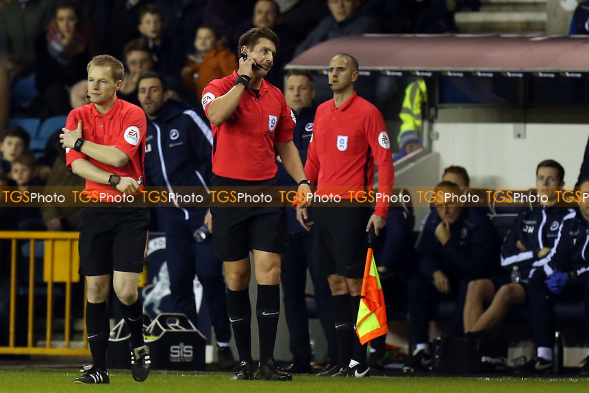 Fourth official Gavin Ward (left) replaces match referee Robert Jones (middle) during Millwall vs Blackburn Rovers, Sky Bet EFL Championship Football at The Den on 12th January 2019