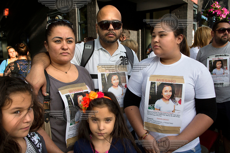 The distraught family and friends of young Jessica Urbano confort each other at a vigil near Grenfell Tower in North Kensington. The 12 year old has been missing since the devastating fire that swept up the 24 storey building in the early hours of Wednesday, 14th June killing at least 79 people and leaving many more without homes or possessions.