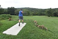 NWA Democrat-Gazette/FLIP PUTTHOFF <br />Brian Richardson plays a scenic hole at his disc golf course.