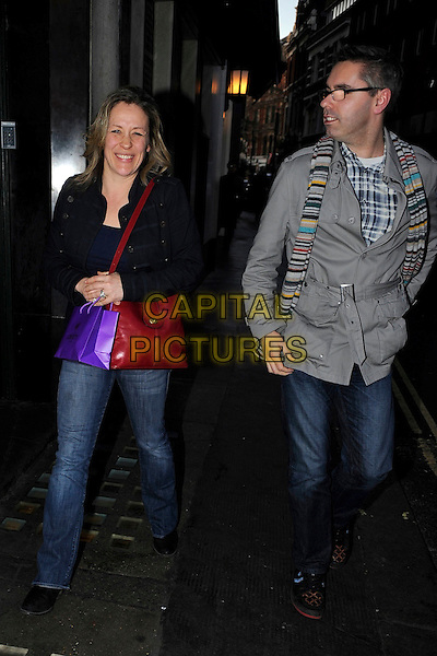 Sarah Beeny & guest.Spotted in London, England..13th January 2012.full length black jacket grey gray jeans denim red bag purse liberty shopping.CAP/IA.©Ian Allis/Capital Pictures.