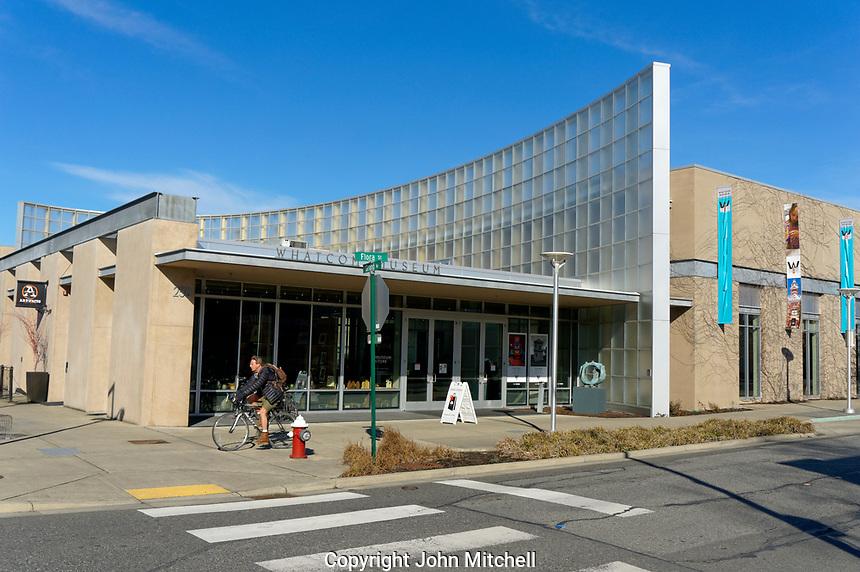 Man o cycling past the Lightcatcher building, Whatcom County Museum, Bellingham, Washington state, USA