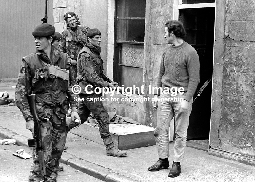 British soldiers quiz a young man in a follow-up arms search in the Markets area of Belfast, N Ireland, after an all-night gun battle. The upsurge in violence was triggered by the introduction of internment. 197108090384b..Copyright Image from Victor Patterson, 54 Dorchester Park, Belfast, United Kingdom, UK...For my Terms and Conditions of Use go to http://www.victorpatterson.com/Victor_Patterson/Terms_%26_Conditions.html