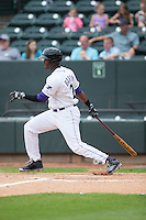 Keon Barnum (20) of the Winston-Salem Dash follows through on his swing against the Myrtle Beach Pelicans at BB&T Ballpark on April 18, 2015 in Winston-Salem, North Carolina.  The Pelicans defeated the Dash 4-1 in game one of a double-header.  (Brian Westerholt/Four Seam Images)