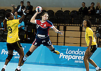 23 NOV 2011 - LONDON, GBR - Britain's Ewa Palies (#17, in blue and red) leaps as she shoots during the 2011 London Handball Cup match against Angola at The Handball Arena in the Olympic Park in Stratford, London  (PHOTO (C) NIGEL FARROW)
