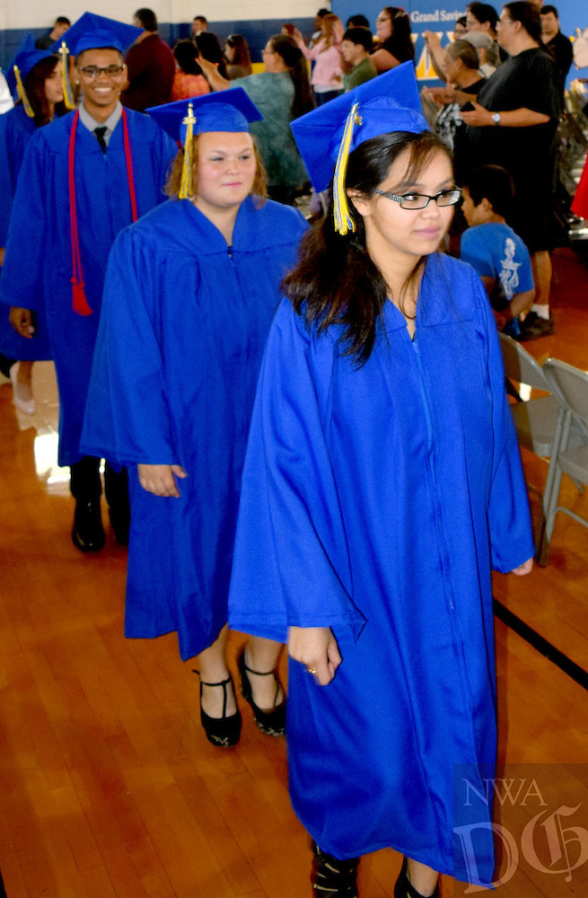 Photo by Mike Eckels<br /> <br /> Maria Molina (right), Sara Moppin, and Alex Morrow march into Peterson Gym as part of the processional opening the 2016 Decatur High School Commencement Ceremony May 15 in Decatur.
