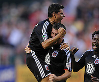 DC United midfielder Chirstian Gomez (10) celebrates with teammate Marc Burch (4) his goal in the 41th minute of the game .  DC United defeated the Chicago Fire 2-1 at  RFK Stadium, Saturday June 13, 2009