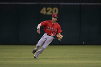 AZL Angels center fielder Jordyn Adams (21) fields a ball during an Arizona League game against the AZL Padres 2 at Tempe Diablo Stadium on July 18, 2018 in Tempe, Arizona. The AZL Padres 2 defeated the AZL Angels 8-1. (Zachary Lucy/Four Seam Images)