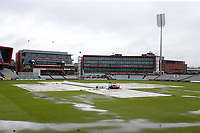 Covers are on the square and large puddles on the outfield as heavy rain falls during Lancashire CCC vs Essex CCC, Specsavers County Championship Division 1 Cricket at Emirates Old Trafford on 5th September 2017