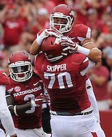 NWA Democrat-Gazette/ANDY SHUPE<br /> Arkansas' Drew Morgan (top) celebrates with Dan Skipper against University of Texas at El Paso's Saturday, Sept. 5, 2015, during the first quarter of play in Razorback Stadium in Fayetteville. Visit nwadg.com/photos to see more from the game.