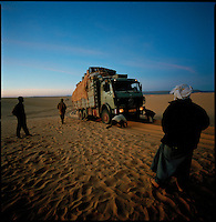 Sahara desert, Libya-Chad, November/December 2004..Every week, a convoy of 40 privately owned Libyan trucks loaded by the WFP with about 1000 metric tons of western food aid cross 2500 km of deep desert across Libya and Chad to reach more than 200 000 refugees from Darfur in camps near the Sudanese border. The convoy crosses the 'Erdi Murdi' (the 'Dunes of the Dead'), a 400 km long and 60 km wide sea of soft sand dunes...
