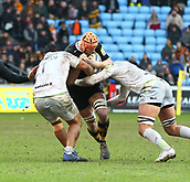 January 7th 2018, Ricoh Arena, Coventry, England;  Aviva Premiership rugby, Wasps versus Saracens;   Kearnan Myall  (Wasps) goes into a tackle by Mako Vunipola (Saracens) during the Aviva Premiership (Round 13) match between Wasps and Saracens rfc at the Ricoh Stadium