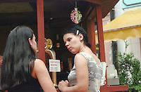 Friends age 23 talking at outdoor sidewalk cafe.  Torun Poland
